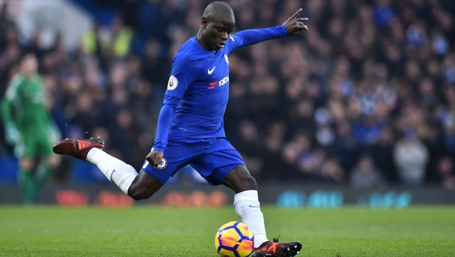 Chelsea's French midfielder N'Golo Kante plays the ball during the English Premier League football match between Chelsea and Leicester City at Stamford Bridge in London on January 13, 2018. / AFP PHOTO / Glyn KIRK / RESTRICTED TO EDITORIAL USE. No use with unauthorized audio, video, data, fixture lists, club/league logos or 'live' services. Online in-match use limited to 75 images, no video emulation. No use in betting, games or single club/league/player publications.  /         (Photo credit should read GLYN KIRK/AFP/Getty Images)