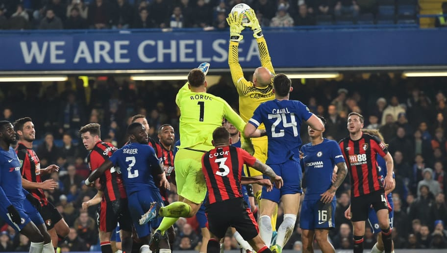 Chelsea's Argentinian goalkeeper Willy Caballero (C) saves the bal from a corner during the English League Cup quarter-final football match between Chelsea and Bournemouth at Stamford Bridge Stadium, in southwest London on December 20, 2017. / AFP PHOTO / Glyn KIRK / RESTRICTED TO EDITORIAL USE. No use with unauthorized audio, video, data, fixture lists, club/league logos or 'live' services. Online in-match use limited to 75 images, no video emulation. No use in betting, games or single club/league/player publications.  /         (Photo credit should read GLYN KIRK/AFP/Getty Images)