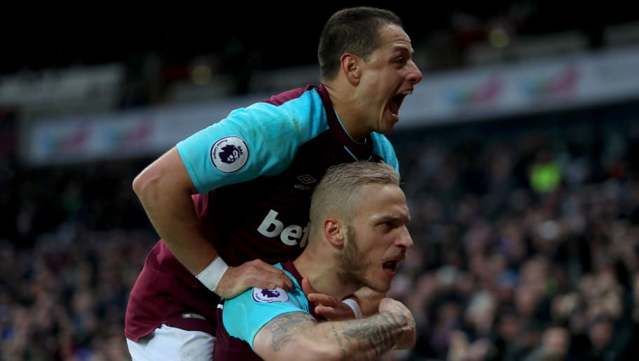 LONDON, ENGLAND - FEBRUARY 10:  Marko Arnautovic of West Ham United celebrates with teammate Javier Hernandez after scoring his sides second goal during the Premier League match between West Ham United and Watford at London Stadium on February 10, 2018 in London, England.  (Photo by Christopher Lee/Getty Images)