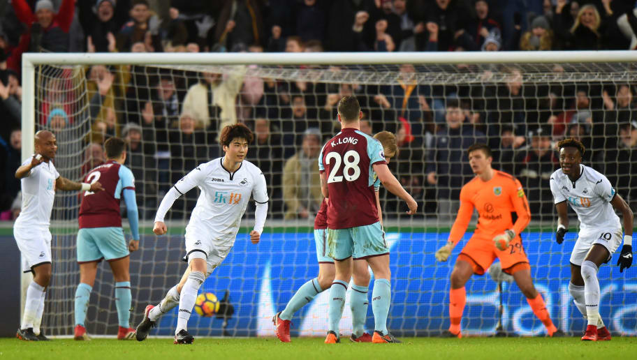 SWANSEA, WALES - FEBRUARY 10:  Ki Sung-Yueng of Swansea City celebrates after scoring his sides first goal during the Premier League match between Swansea City and Burnley at Liberty Stadium on February 10, 2018 in Swansea, Wales.  (Photo by Tony Marshall/Getty Images)