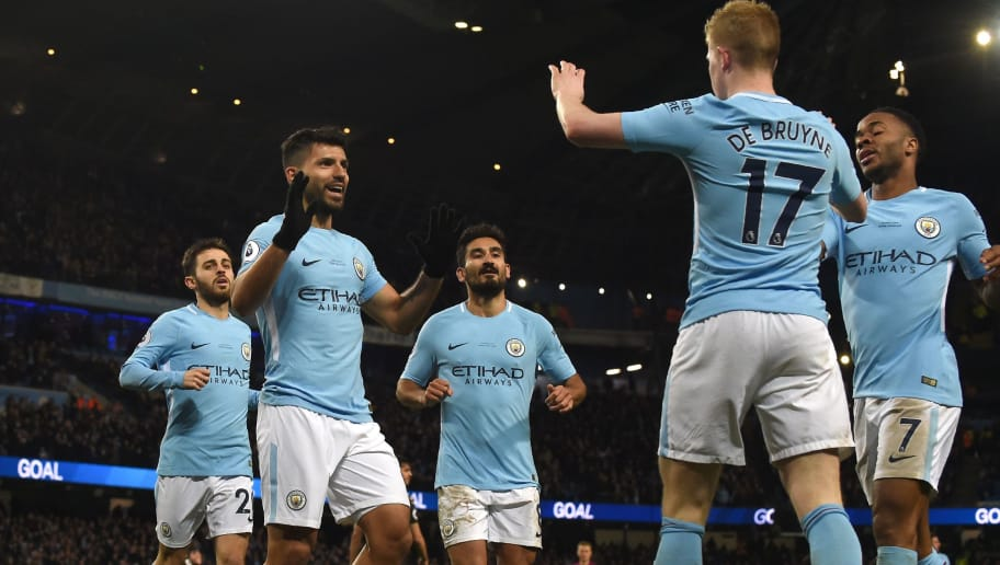 Manchester City's Argentinian striker Sergio Aguero (2L) celebrates scoring the team's second goal during the English Premier League football match between Manchester City and Leicester City at the Etihad Stadium in Manchester, north west England, on February 10, 2018. / AFP PHOTO / PAUL ELLIS / RESTRICTED TO EDITORIAL USE. No use with unauthorized audio, video, data, fixture lists, club/league logos or 'live' services. Online in-match use limited to 75 images, no video emulation. No use in betting, games or single club/league/player publications.  /         (Photo credit should read PAUL ELLIS/AFP/Getty Images)