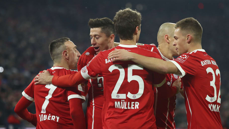 MUNICH, GERMANY - FEBRUARY 10: Robert Lewandowski of Bayern Muenchen (2nd left) celebrates with his team after he scored to make it 1:0 during the Bundesliga match between FC Bayern Muenchen and FC Schalke 04 at Allianz Arena on February 10, 2018 in Munich, Germany. (Photo by Alex Grimm/Bongarts/Getty Images)