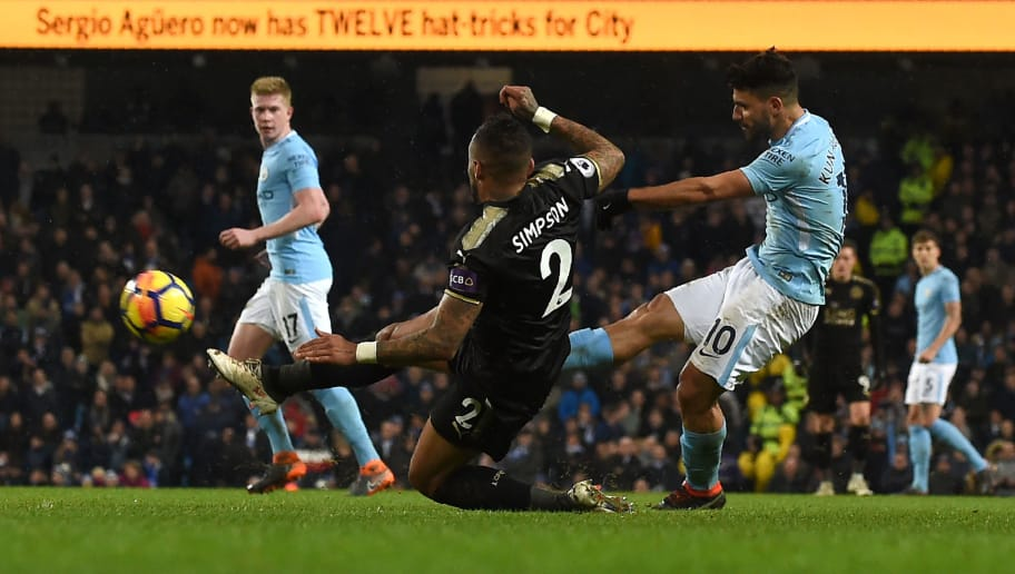 Manchester City's Argentinian striker Sergio Aguero (R) shoots to score their fifth goal, his fourth during the English Premier League football match between Manchester City and Leicester City at the Etihad Stadium in Manchester, north west England, on February 10, 2018. Manchester City won the game 5-1. / AFP PHOTO / PAUL ELLIS / RESTRICTED TO EDITORIAL USE. No use with unauthorized audio, video, data, fixture lists, club/league logos or 'live' services. Online in-match use limited to 75 images, no video emulation. No use in betting, games or single club/league/player publications.  /         (Photo credit should read PAUL ELLIS/AFP/Getty Images)