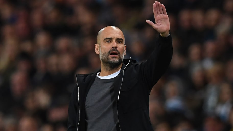 Manchester City's Spanish manager Pep Guardiola gestures on the touchline during the English Premier League football match between Manchester City and Leicester City at the Etihad Stadium in Manchester, north west England, on February 10, 2018. / AFP PHOTO / Paul ELLIS / RESTRICTED TO EDITORIAL USE. No use with unauthorized audio, video, data, fixture lists, club/league logos or 'live' services. Online in-match use limited to 75 images, no video emulation. No use in betting, games or single club/league/player publications.  /         (Photo credit should read PAUL ELLIS/AFP/Getty Images)