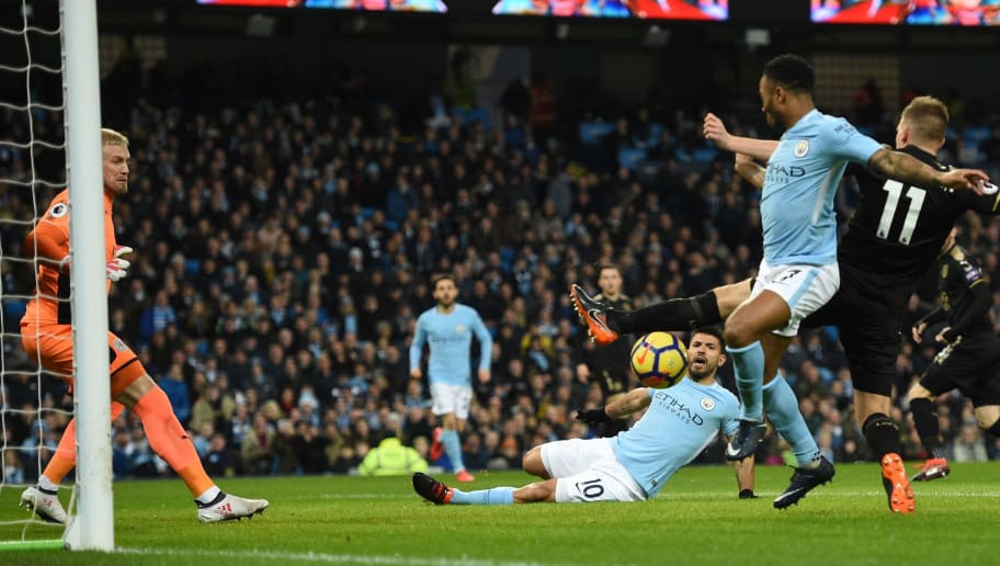 Manchester City's English midfielder Raheem Sterling (2nd R) scores the opening goal of the English Premier League football match between Manchester City and Leicester City at the Etihad Stadium in Manchester, north west England, on February 10, 2018. / AFP PHOTO / Oli SCARFF / RESTRICTED TO EDITORIAL USE. No use with unauthorized audio, video, data, fixture lists, club/league logos or 'live' services. Online in-match use limited to 75 images, no video emulation. No use in betting, games or single club/league/player publications.  /         (Photo credit should read OLI SCARFF/AFP/Getty Images)