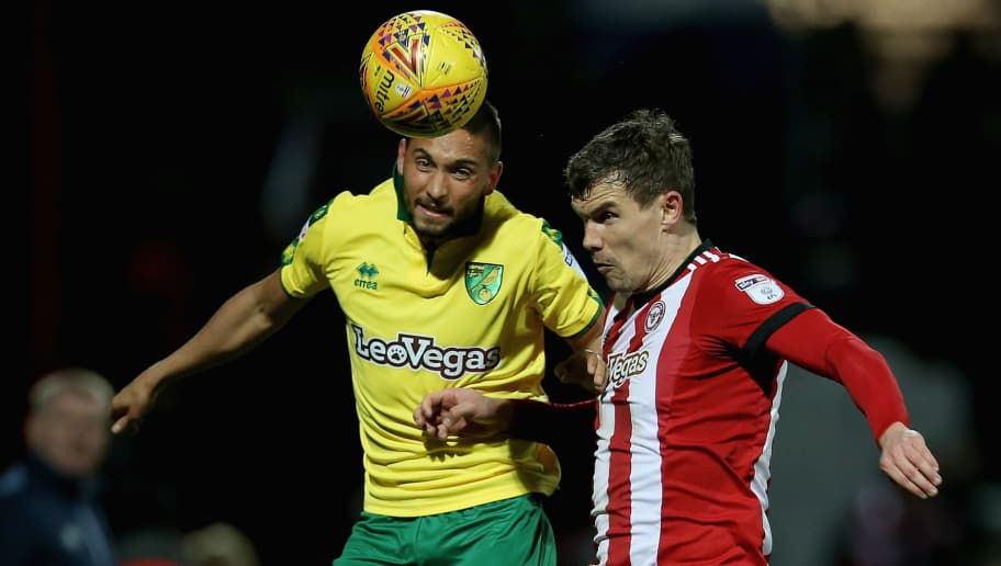 BRENTFORD, ENGLAND - JANUARY 27: Moritz Leitner of Norwich City and Andreas Bjelland of Brentford vie for the ball during the Sky Bet Championship match between Brentford and Norwich City at Griffin Park on January 27, 2018 in Brentford, England. (Photo by Harry Murphy/Getty Images)