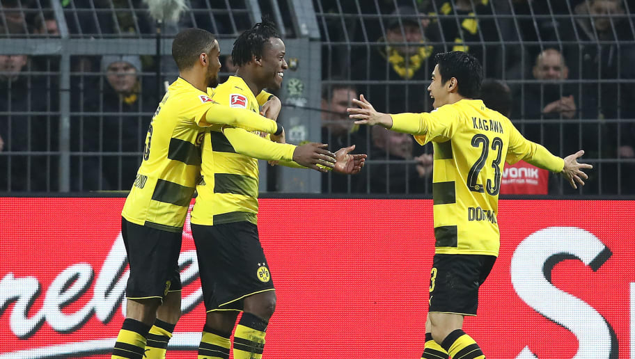 DORTMUND, GERMANY - FEBRUARY 10: Michy Batshuayi of Dortmund (2nd left) celebrates with his team after he scored a goal to make it 1:0 during the Bundesliga match between Borussia Dortmund and Hamburger SV at Signal Iduna Park on February 10, 2018 in Dortmund, Germany. (Photo by Oliver Hardt/Bongarts/Getty Images)