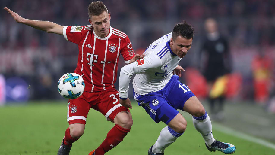 MUNICH, GERMANY - FEBRUARY 10: Joshua Kimmich of Bayern Muenchen (l) fights for the ball with Yevhen Konopljanka of Schalke during the Bundesliga match between FC Bayern Muenchen and FC Schalke 04 at Allianz Arena on February 10, 2018 in Munich, Germany. (Photo by Alex Grimm/Bongarts/Getty Images)