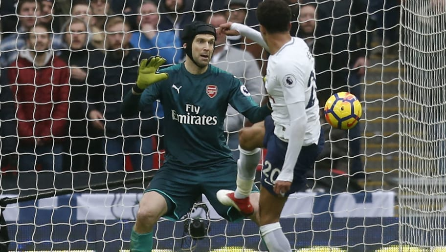 Tottenham Hotspur's English midfielder Dele Alli (R) shoots wide to miss a chance as Arsenal's Czech goalkeeper Petr Cech (L) eyes the ball during the English Premier League football match between Tottenham Hotspur and Arsenal at Wembley Stadium in London, on February 10, 2018. / AFP PHOTO / IKIMAGES / Ian KINGTON / RESTRICTED TO EDITORIAL USE. No use with unauthorized audio, video, data, fixture lists, club/league logos or 'live' services. Online in-match use limited to 45 images, no video emulation. No use in betting, games or single club/league/player publications.  /         (Photo credit should read IAN KINGTON/AFP/Getty Images)