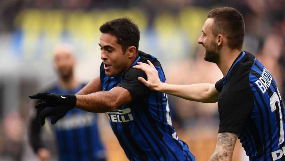 Inter Milan's Italian forward Citadin Martins Eder (L) celebrates after scoring a goal during the Italian Serie A football match Inter Milan versus Bologna on February 11, 2018 at the San Siro Stadium in Milan. / AFP PHOTO / MARCO BERTORELLO        (Photo credit should read MARCO BERTORELLO/AFP/Getty Images)