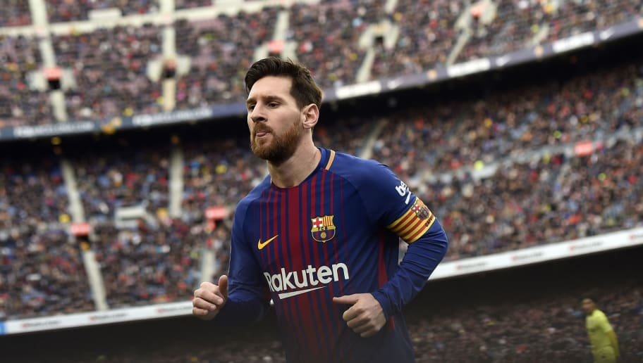 Barcelona's Argentinian forward Lionel Messi runs during the Spanish league football match between FC Barcelona and Getafe CF at the Camp Nou stadium in Barcelona on February 11, 2018. / AFP PHOTO / Josep LAGO        (Photo credit should read JOSEP LAGO/AFP/Getty Images)