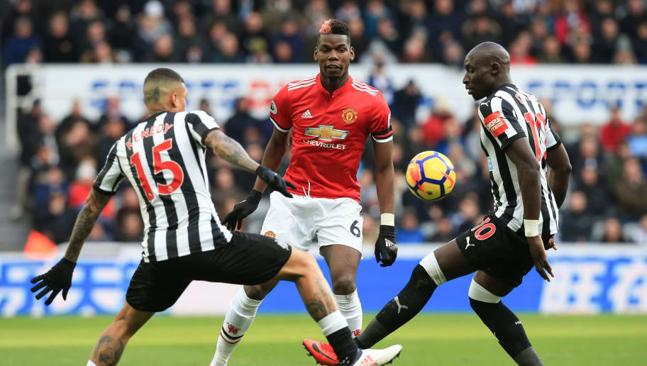 Manchester United's French midfielder Paul Pogba (C) is challenged by Newcastle United's Senegalese midfielder Mohamed Diame (R) and Newcastle United's Brazilian midfielder Kenedy (L) during the English Premier League football match between Newcastle United and Manchester United at St James' Park in Newcastle-upon-Tyne, north east England on February 11, 2018. / AFP PHOTO / Lindsey PARNABY / RESTRICTED TO EDITORIAL USE. No use with unauthorized audio, video, data, fixture lists, club/league logos or 'live' services. Online in-match use limited to 75 images, no video emulation. No use in betting, games or single club/league/player publications.  /         (Photo credit should read LINDSEY PARNABY/AFP/Getty Images)