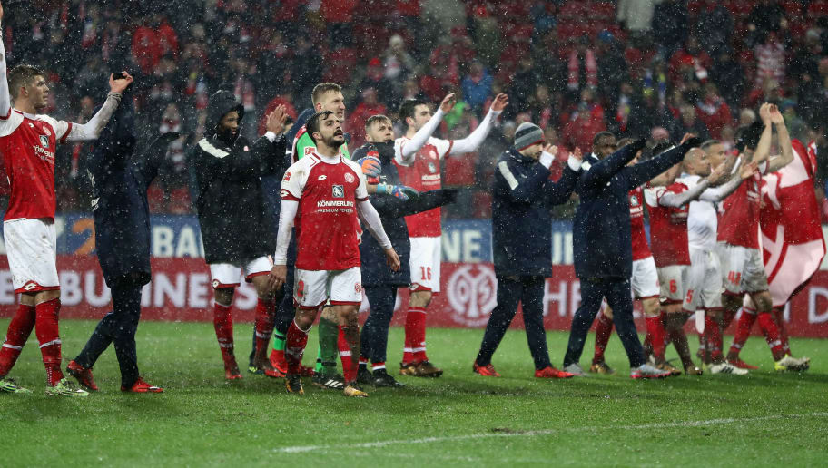 MAINZ, GERMANY - JANUARY 20: Players of Mainz celebrate with the fans after the Bundesliga match between 1. FSV Mainz 05 and VfB Stuttgart at Opel Arena on January 20, 2018 in Mainz, Germany.  (Photo by Alex Grimm/Bongarts/Getty Images)