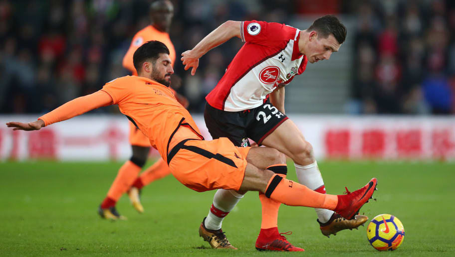 SOUTHAMPTON, ENGLAND - FEBRUARY 11: Emre Can of Liverpool tackles Pierre-Emile Hojbjerg of Southampton during the Premier League match between Southampton and Liverpool at St Mary's Stadium on February 11, 2018 in Southampton, England.  (Photo by Julian Finney/Getty Images)