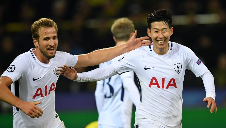 DORTMUND, GERMANY - NOVEMBER 21:  Heung-Min Son of Tottenham Hotspur and Harry Kane of Tottenham Hotspur celebrates after Heung-Min Son of Tottenham Hotspur scored their sides second goal during the UEFA Champions League group H match between Borussia Dortmund and Tottenham Hotspur at Signal Iduna Park on November 21, 2017 in Dortmund, Germany.  (Photo by Stuart Franklin/Getty Images)