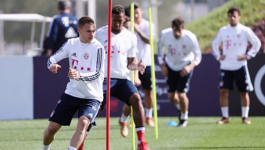 DOHA, QATAR - JANUARY 07:  Joshua Kimmich and team mates exercise during a training session on day 6 of the FC Bayern Muenchen training camp at ASPIRE Academy for Sports Excellence on January 7, 2018 in Doha, Qatar.  (Photo by Alex Grimm/Bongarts/Getty Images)