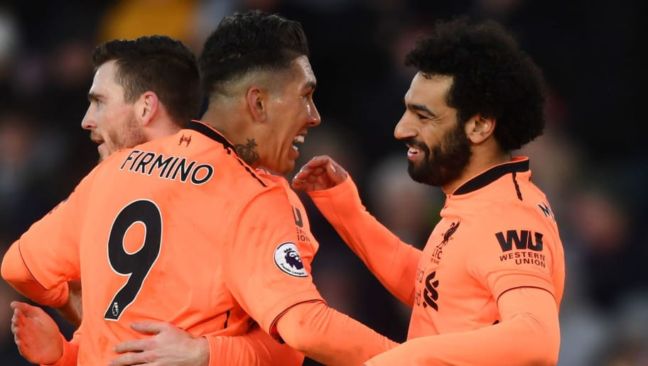 SOUTHAMPTON, ENGLAND - FEBRUARY 11: Mohamed Salah of Liverpool celebrates after scoring his sides second goal with Roberto Firmino of Liverpool during the Premier League match between Southampton and Liverpool at St Mary's Stadium on February 11, 2018 in Southampton, England.  (Photo by Michael Regan/Getty Images)