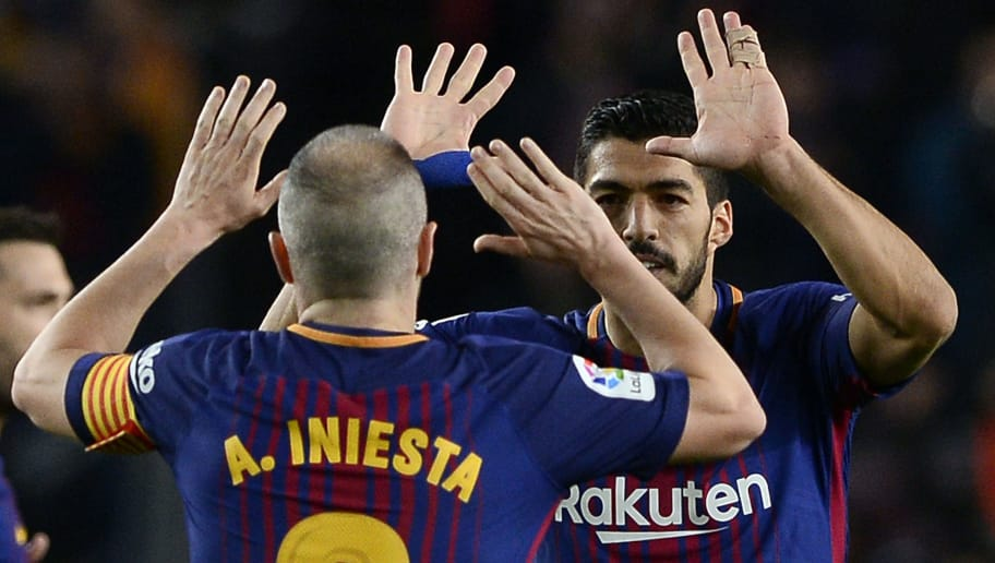 Barcelona's Uruguayan forward Luis Suarez (R) celebrates a goal with Barcelona's Spanish midfielder Andres Iniesta during the Spanish league football match between FC Barcelona and Deportivo Alaves at the Camp Nou stadium in Barcelona on January 28, 2018. / AFP PHOTO / Josep LAGO        (Photo credit should read JOSEP LAGO/AFP/Getty Images)