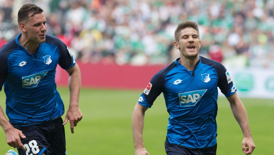 Hoffenheim's Hungarian forward Adam Szalai and Hoffenheim's Croatian forward Andrej Kramaric celebrate after scoring the 4:0 during the German first division Bundesliga football match between Werder Bremen and TSG Hoffenheim on May 13, 2017 in Bremen, northern Germany.  / AFP PHOTO / JOERG SARBACH / RESTRICTIONS: DURING MATCH TIME: DFL RULES TO LIMIT THE ONLINE USAGE TO 15 PICTURES PER MATCH AND FORBID IMAGE SEQUENCES TO SIMULATE VIDEO. == RESTRICTED TO EDITORIAL USE == FOR FURTHER QUERIES PLEASE CONTACT DFL DIRECTLY AT + 49 69 650050         (Photo credit should read JOERG SARBACH/AFP/Getty Images)