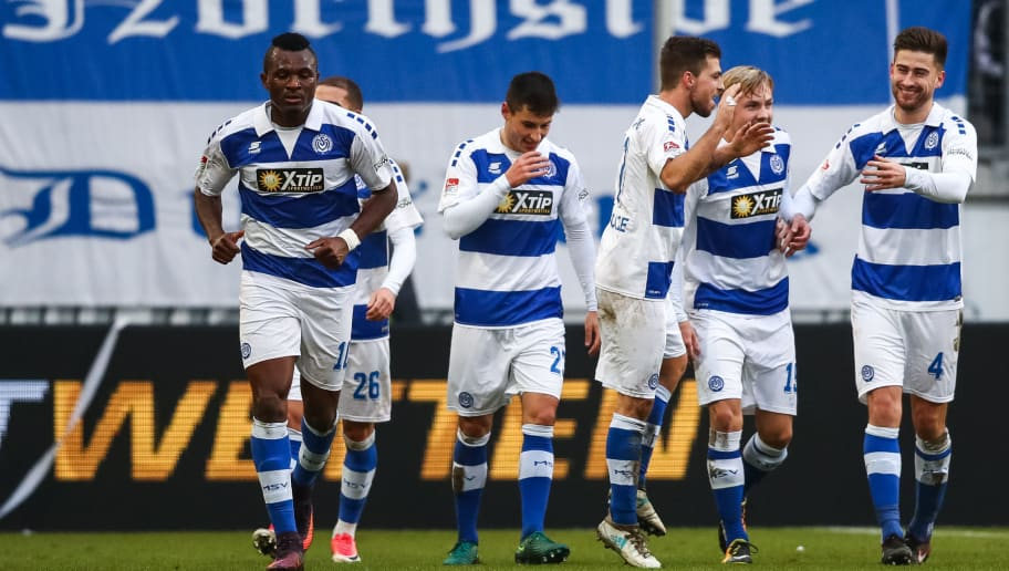 DUISBURG, GERMANY - DECEMBER 17: Kevin Wolze #17 of MSV Duisburg celebrates with his team-mates after scoring his team's second goal to make it 2-0 during the Second Bundesliga match between MSV Duisburg and SG Dynamo Dresden at Schauinsland-Reisen-Arena on December 17, 2017 in Duisburg, Germany. (Photo by Dean Mouhtaropoulos/Bongarts/Getty Images)