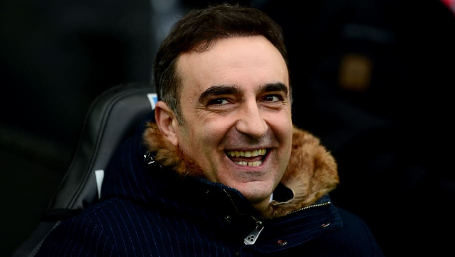 SWANSEA, WALES - FEBRUARY 10:  Carlos Carvalhal, Manager of Swansea City looks on ahead of the Premier League match between Swansea City and Burnley at Liberty Stadium on February 10, 2018 in Swansea, Wales.  (Photo by Harry Trump/Getty Images)