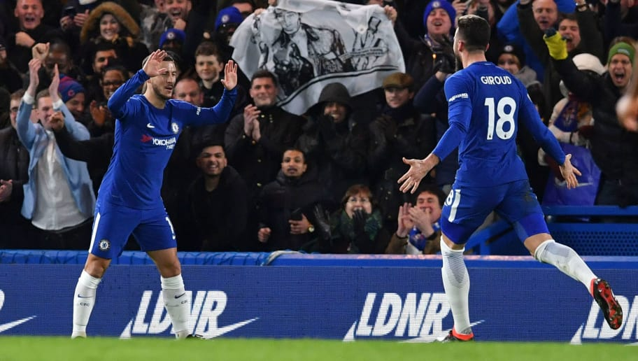 Chelsea's Belgian midfielder Eden Hazard (L) celebrates with Chelsea's French attacker Olivier Giroud (R) after scoring the opening goal during the English Premier League football match between Chelsea and West Bromwich Albion at Stamford Bridge in London on February 12, 2018. / AFP PHOTO / Ben STANSALL / RESTRICTED TO EDITORIAL USE. No use with unauthorized audio, video, data, fixture lists, club/league logos or 'live' services. Online in-match use limited to 75 images, no video emulation. No use in betting, games or single club/league/player publications.  /         (Photo credit should read BEN STANSALL/AFP/Getty Images)