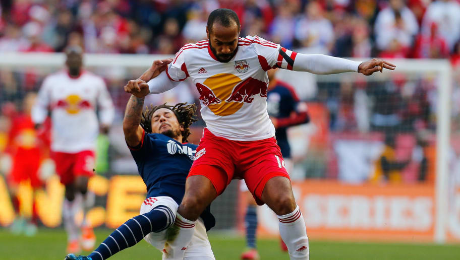 HARRISON, NJ - NOVEMBER 23:  Thierry Henry #14 of New York Red Bulls knocks Jermaine Jones #13 of New England Revolution off the ball the during the Eastern Conference Final - Leg 1 at Red Bull Arena on November 23, 2014 in Harrison, New Jersey.  (Photo by Mike Stobe/Getty Images)