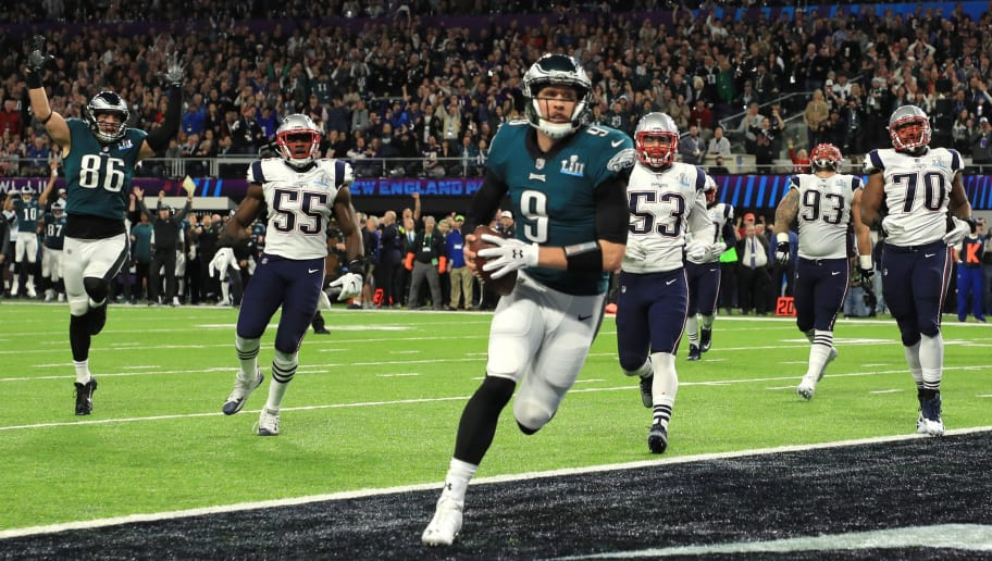 MINNEAPOLIS, MN - FEBRUARY 04:  Nick Foles #9 of the Philadelphia Eagles catches a 1-yard touchdown pass against the New England Patriots during the second quarter in Super Bowl LII at U.S. Bank Stadium on February 4, 2018 in Minneapolis, Minnesota.  (Photo by Mike Ehrmann/Getty Images)