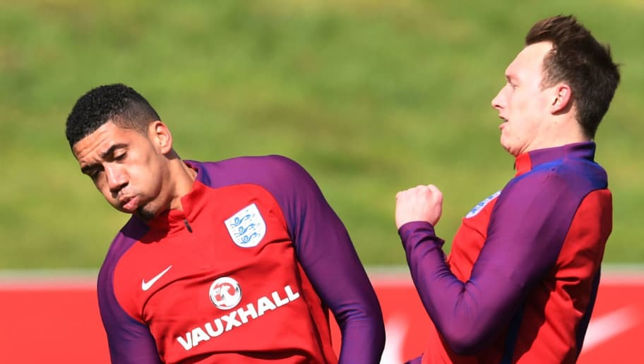 England's defender Phil Jones and England's defender Chris Smalling (L) clash during a team training session at St George's Park in Burton-on-Trent on March 21, 2017, ahead of their friendly international football match against Germany in Dortmund on March 22. After a year scarred by scandal and sporting catastrophe, Gareth Southgate will begin his attempt to steer England into calmer waters in Wednesday's friendly against Germany in Dortmund. / AFP PHOTO / PAUL ELLIS / NOT FOR MARKETING OR ADVERTISING USE / RESTRICTED TO EDITORIAL USE         (Photo credit should read PAUL ELLIS/AFP/Getty Images)