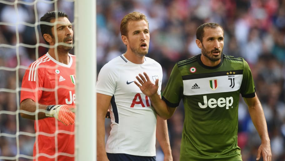 LONDON, ENGLAND - AUGUST 05: Harry Kane of Tottenham is marked by Gianluigi Buffon and Giorgio Chiellini of Juve during the pre-season match between Tottenham Hotspur and Juventus at Wembley Stadium on August 5, 2017 in London, England.  (Photo by Michael Regan/Getty Images)