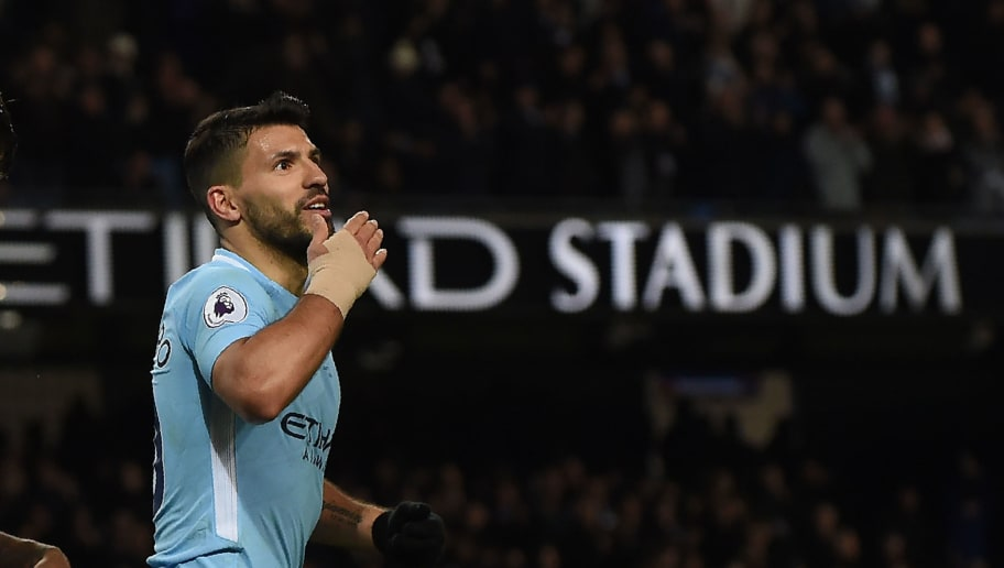Manchester City's Argentinian striker Sergio Aguero celebrates after scoring their fourth goal, his third during the English Premier League football match between Manchester City and Leicester City at the Etihad Stadium in Manchester, north west England, on February 10, 2018. / AFP PHOTO / PAUL ELLIS / RESTRICTED TO EDITORIAL USE. No use with unauthorized audio, video, data, fixture lists, club/league logos or 'live' services. Online in-match use limited to 75 images, no video emulation. No use in betting, games or single club/league/player publications.  /         (Photo credit should read PAUL ELLIS/AFP/Getty Images)
