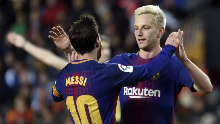 Barcelona's Croatian midfielder Ivan Rakitic (R) celebrates a goal with Barcelona's Argentinian forward Lionel Messi during the Spanish 'Copa del Rey' (King's cup) second leg semi-final football match between Valencia CF and FC Barcelona at the Mestalla stadium in Valencia on February 8, 2018. / AFP PHOTO / JOSE JORDAN        (Photo credit should read JOSE JORDAN/AFP/Getty Images)