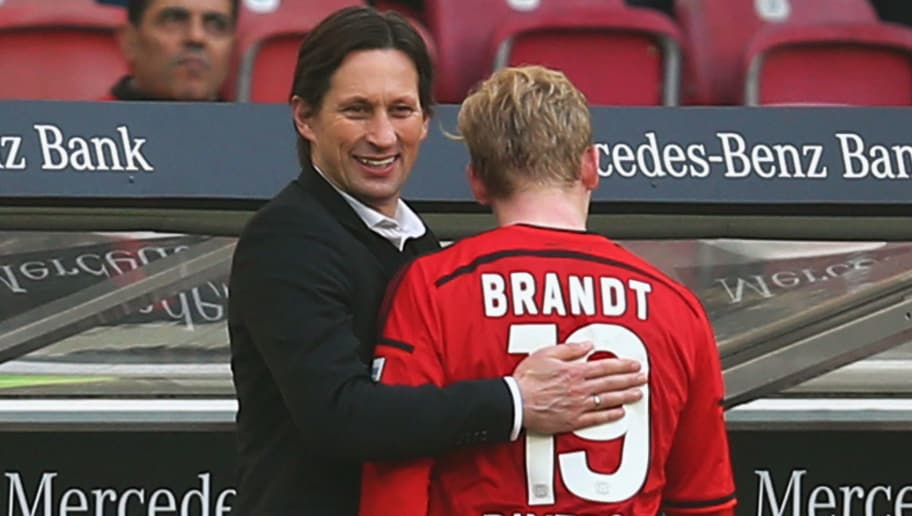 STUTTGART, GERMANY - MARCH 20:  Head coach Roger Schmidt of Leverkusen hugs Julian Brandt during the Bundesliga match between VfB Stuttgart and Bayer Leverkusen at Mercedes-Benz Arena on March 20, 2016 in Stuttgart, Germany.  (Photo by Alex Grimm/Bongarts/Getty Images)