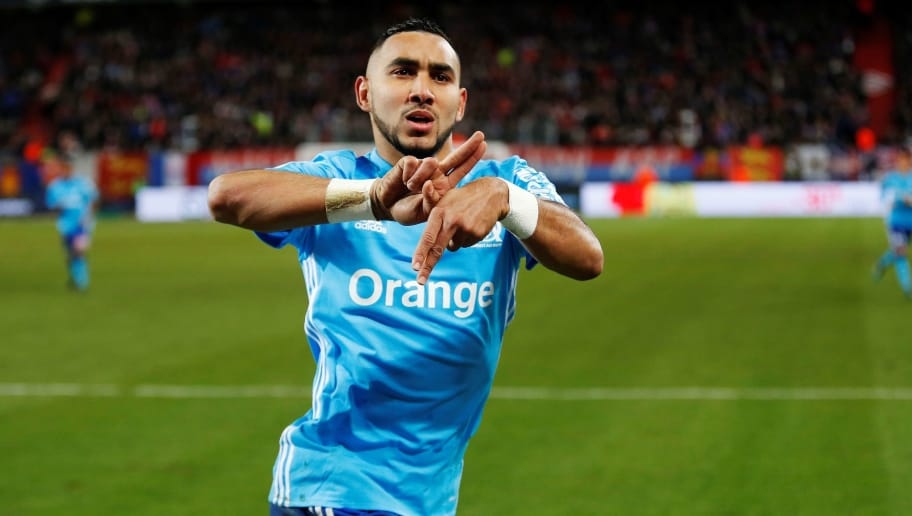 Olympique de Marseille's French forward Dimitri Payet celebrates after scoring during the French L1 football match between Caen (SMC) and Marseille (OM) on January 19, 2018, at the Michel d'Ornano stadium, in Caen, northwestern France.  / AFP PHOTO / CHARLY TRIBALLEAU        (Photo credit should read CHARLY TRIBALLEAU/AFP/Getty Images)