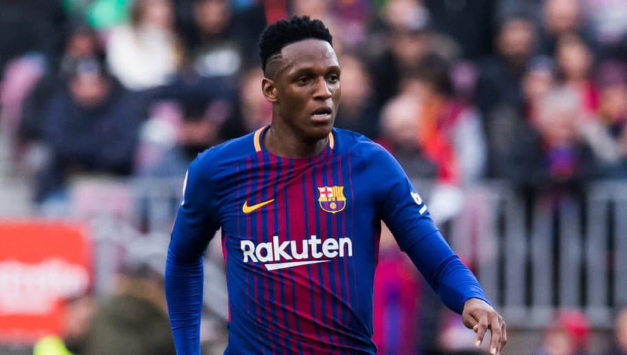 BARCELONA, SPAIN - FEBRUARY 11:  Yerry Mina of FC Barcelona conducts the ball during the La Liga match between Barcelona and Getafe at Camp Nou on February 11, 2018 in Barcelona, Spain.  (Photo by Alex Caparros/Getty Images)
