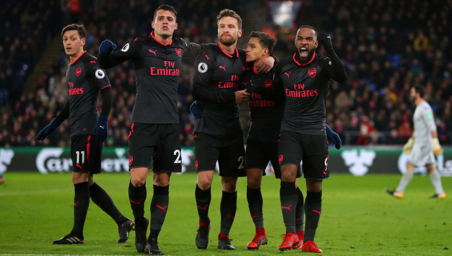 LONDON, ENGLAND - DECEMBER 28: Alexis Sanchez of Arsenal celebrates with Granit Xhaka,Shkodran Mustafi and Alexandre Lacazette of Arsenal during the Premier League match between Crystal Palace and Arsenal at Selhurst Park on December 28, 2017 in London, England. (Photo by Catherine Ivill/Getty Images)