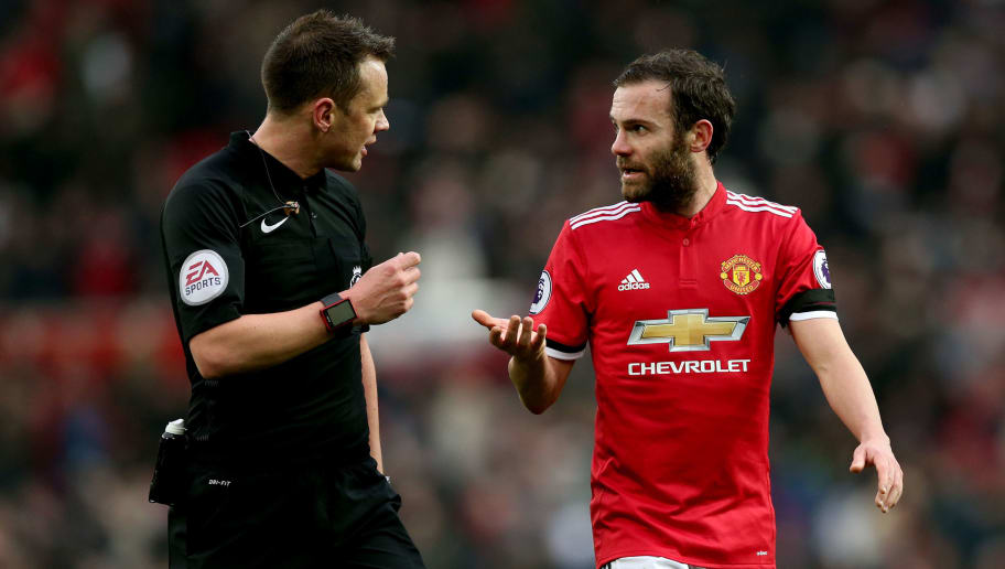MANCHESTER, ENGLAND - FEBRUARY 03:  Juan Mata of Manchester United speaks to the match referee as they walk off the pitch for half time during the Premier League match between Manchester United and Huddersfield Town at Old Trafford on February 3, 2018 in Manchester, England.  (Photo by Alex Morton/Getty Images)