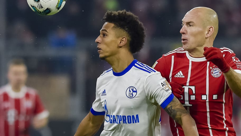 Schalke's German defender Thilo Kehrer (L) and Bayern Munich's Dutch midfielder Arjen Robben vie for the ball during the German first division Bundesliga football match FC Bayern Munich vs Schalke 04 in Munich, southern Germany on February 10, 2018. / AFP PHOTO / Guenter SCHIFFMANN / RESTRICTIONS: DURING MATCH TIME: DFL RULES TO LIMIT THE ONLINE USAGE TO 15 PICTURES PER MATCH AND FORBID IMAGE SEQUENCES TO SIMULATE VIDEO. == RESTRICTED TO EDITORIAL USE == FOR FURTHER QUERIES PLEASE CONTACT DFL DIRECTLY AT + 49 69 650050         (Photo credit should read GUENTER SCHIFFMANN/AFP/Getty Images)