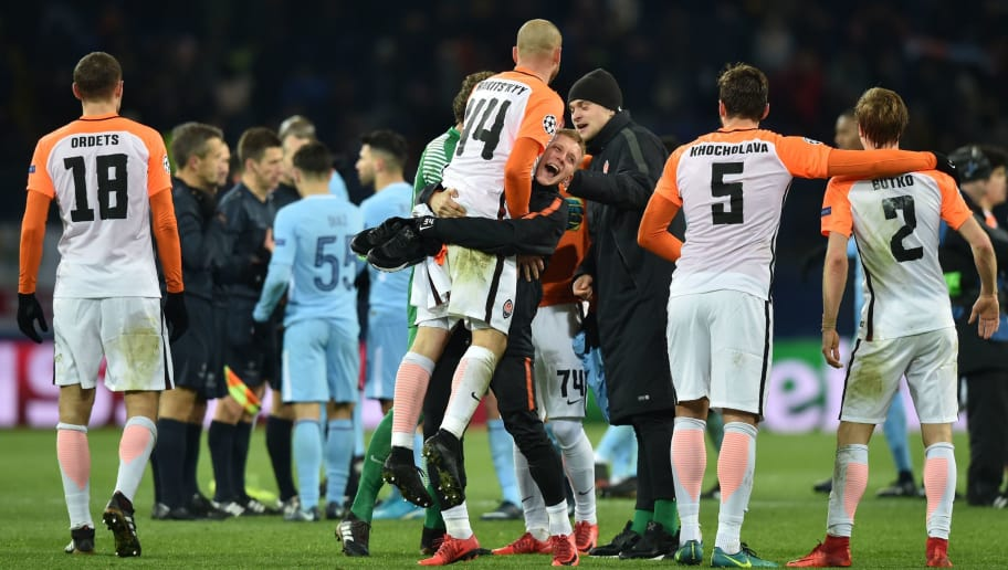 Shakhtar's players celebrate after winning the UEFA Champions League group F football match between Shakhtar Donetsk and Manchester City, on December 6, 2017, at the Metalist stadium in Kharkiv, Eastern Ukraine. / AFP PHOTO / Genya SAVILOV        (Photo credit should read GENYA SAVILOV/AFP/Getty Images)