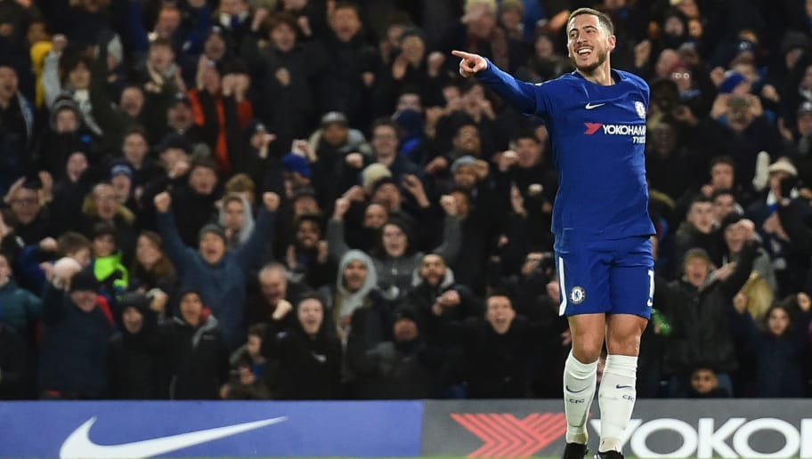 Chelsea's Belgian midfielder Eden Hazard celebrates scoring the opening goal during the English Premier League football match between Chelsea and West Bromwich Albion at Stamford Bridge in London on February 12, 2018. / AFP PHOTO / Glyn KIRK / RESTRICTED TO EDITORIAL USE. No use with unauthorized audio, video, data, fixture lists, club/league logos or 'live' services. Online in-match use limited to 75 images, no video emulation. No use in betting, games or single club/league/player publications.  /         (Photo credit should read GLYN KIRK/AFP/Getty Images)