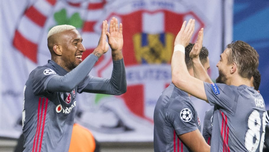 Besiktas' Brazilian midfielder Talisca (L) celebrates scoring with his teammate Turkish defender Caner Erkin during the UEFA Champions League group G football match RB Leipzig vs Besiktas in Leipzig, eastern Germany, on December 6, 2017. / AFP PHOTO / ROBERT MICHAEL        (Photo credit should read ROBERT MICHAEL/AFP/Getty Images)