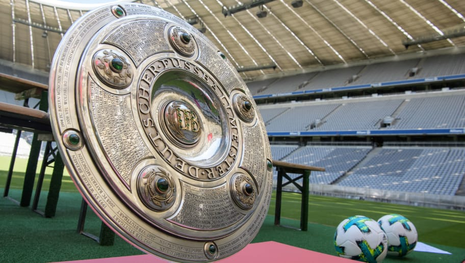 MUNICH, GERMANY - AUGUST 08: The Bundesliga trophy sits on a podium during the team presentation at Allianz Arena of FC Bayern Muenchen on August 8, 2017 in Munich, Germany. (Photo by Sebastian Widmann/Bongarts/Getty Images)