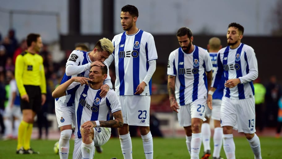 Porto's Brazilian forward Soares (2L) is congratulated by teammates after scoring a goal during the Portuguese league football match between GD Chaves and FC Porto at the Municipal Eng. Manuel Branco Teixeira stadium in Chaves on February 11, 2018. / AFP PHOTO / MIGUEL RIOPA        (Photo credit should read MIGUEL RIOPA/AFP/Getty Images)