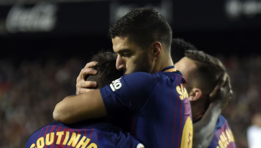 Barcelona's Uruguayan forward Luis Suarez (R) kisses Barcelona's Brazilian midfielder Philippe Coutinho (L) to congratulate him for his goal during the Spanish 'Copa del Rey' (King's cup) second leg semi-final football match between Valencia CF and FC Barcelona at the Mestalla stadium in Valencia on February 8, 2018. / AFP PHOTO / JOSE JORDAN        (Photo credit should read JOSE JORDAN/AFP/Getty Images)