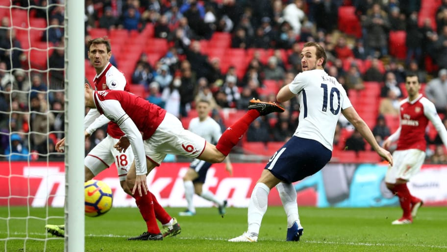 LONDON, ENGLAND - FEBRUARY 10:  Harry Kane of Tottenham Hotspur scores his side's first goal during the Premier League match between Tottenham Hotspur and Arsenal at Wembley Stadium on February 10, 2018 in London, England.  (Photo by Catherine Ivill/Getty Images)