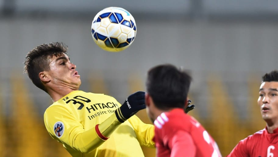 Japan's Kashiwa Reysol forward Cristiano (L) controls the ball next to Vietnam's Binh Duong forward Le Cong Vinh (C) and defender Dang Van Robert (R) during their AFC Champions League Group Stage football match in Kashiwa on March 3, 2015.  AFP PHOTO / KAZUHIRO NOGI        (Photo credit should read KAZUHIRO NOGI/AFP/Getty Images)