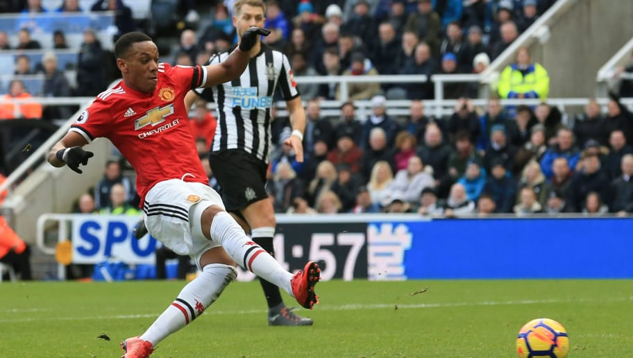 Manchester United's French striker Anthony Martial shoots but misses the chance during the English Premier League football match between Newcastle United and Manchester United at St James' Park in Newcastle-upon-Tyne, north east England on February 11, 2018. / AFP PHOTO / Lindsey PARNABY / RESTRICTED TO EDITORIAL USE. No use with unauthorized audio, video, data, fixture lists, club/league logos or 'live' services. Online in-match use limited to 75 images, no video emulation. No use in betting, games or single club/league/player publications.  /         (Photo credit should read LINDSEY PARNABY/AFP/Getty Images)
