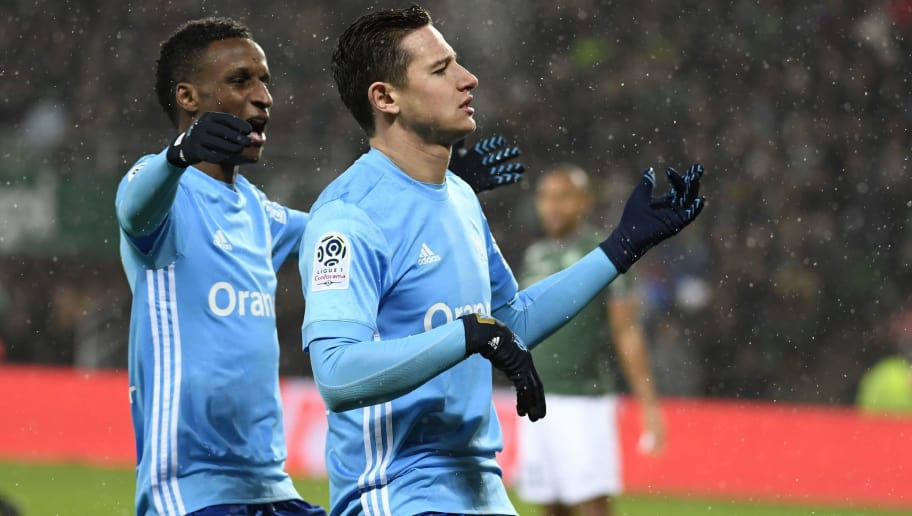 Marseille's French midfielder Florian Thauvin (R) celebrates with Marseille's French forward Bouna Sarr after scoring a goal during the French L1 football match between AS Saint-Etienne and Olympique de Marseille on February 9, 2018 at the Geoffroy Guichard stadium in Saint-Etienne, central France. / AFP PHOTO / PHILIPPE DESMAZES        (Photo credit should read PHILIPPE DESMAZES/AFP/Getty Images)