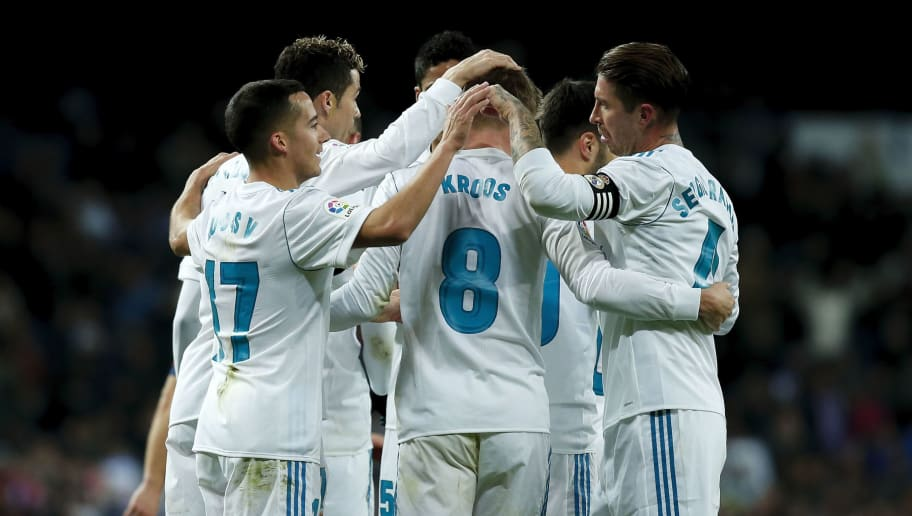 MADRID, SPAIN - JANUARY 28: Toni Kroos (2ndR) of Real Madrid CF celebrates scoring their third goal with teammates during the La Liga match between Club Atletico Madrid and UD Las Palmas at Estadio Wanda Metropolitano on January 28, 2018 in Madrid, Spain. (Photo by Gonzalo Arroyo Moreno/Getty Images)
