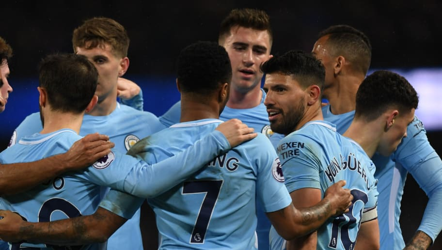 Manchester City's Argentinian striker Sergio Aguero (3rd R) celebrates with teammates after scoring their fifth goal, his fourth during the English Premier League football match between Manchester City and Leicester City at the Etihad Stadium in Manchester, north west England, on February 10, 2018. Manchester City won the game 5-1. / AFP PHOTO / PAUL ELLIS / RESTRICTED TO EDITORIAL USE. No use with unauthorized audio, video, data, fixture lists, club/league logos or 'live' services. Online in-match use limited to 75 images, no video emulation. No use in betting, games or single club/league/player publications.  /         (Photo credit should read PAUL ELLIS/AFP/Getty Images)